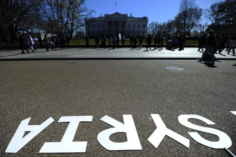<p>Placards are displayed during a demonstration against the Syrian president Bashar al Assad in front of the White House in Washington, DC, on Mar. 10, 2012.</p>