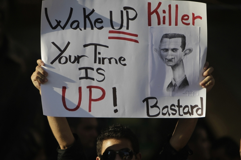 <p>A Lebanese man carries a sign calling on Syrian President Bashar al-Assad to step down during a rally in support of Syria's ongoing anti-regime uprising in downtown Beirut on September 8, 2011. Some believe more than 3,000 have been killed in the uprising so far.</p>