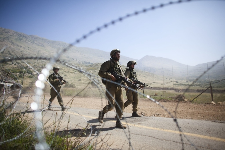 <p>Israeli soldiers operate along Israel's border with Syria.</p>