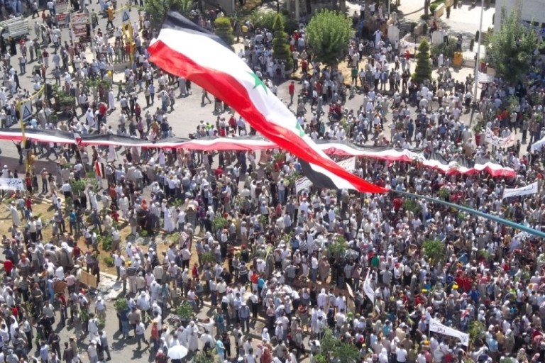 <p>Anti-government protesters gather in Hama, Syria Friday where the U.S. and French ambassadors witnessed the demonstration.</p>