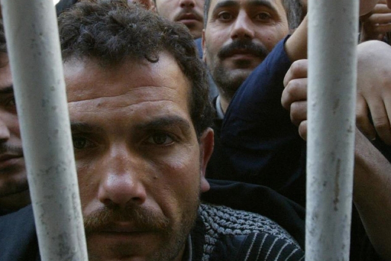 <p>Syrian prisoners stage a protest and a hunger strike at a prison near Damascus in 2005.</p>