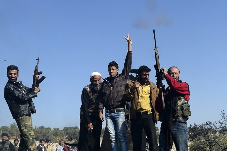 <p>Syrian rebels celebrate a recent victory.</p>