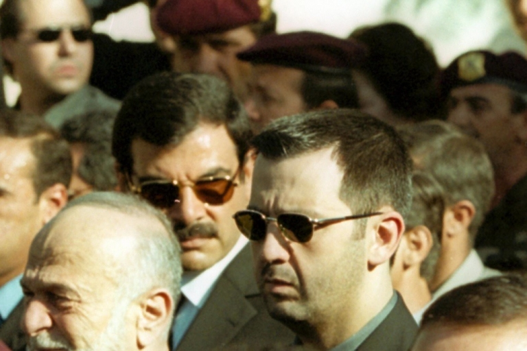 <p>Maher al-Assad attends the funeral of late Syrian president Hafez al-Assad in Damascus on June 13, 2000. Maher is now leading his elite military units around the country to violently quell protests.</p>