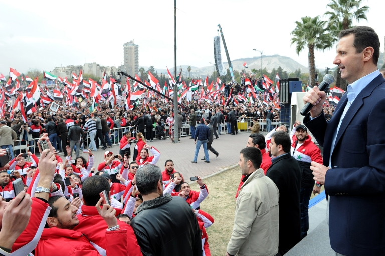<p>Syria's President Basar al-Assad makes an appearance at a rally with his supporters.</p>