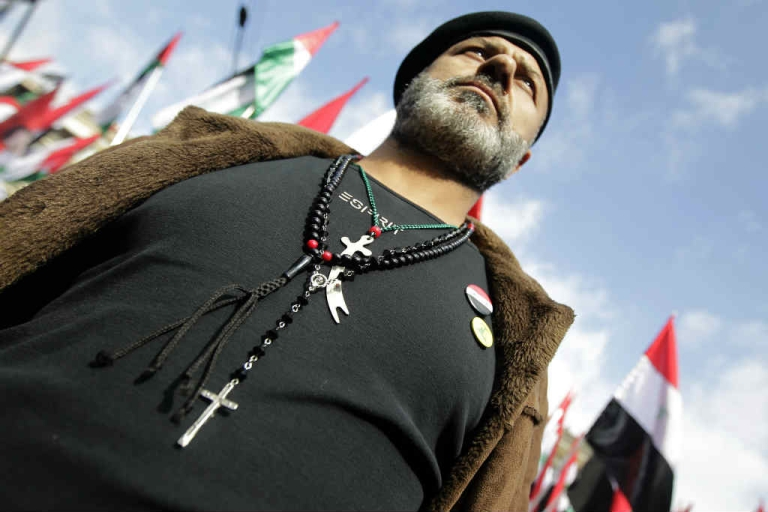 <p>A Syrian supporter of President Bashar Assad wears a Christian rosary, Sunni praying beads and a Shiite Imam Ali sword around his neck.  But the days of the Arab Spring are long gone, as the war in Syria has turned into a Sunni vs. Shiite rivalry.</p>