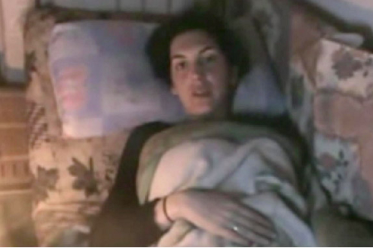 <p>A still from a video posted on Youtube in which French journalist Edith Bouvier described her injuries and pleaded to be evacuated from the Syrian city of Homs</p>