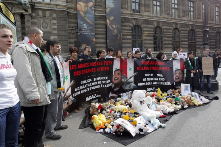 <p>Opponents to the Syrian president hold a banner which denounces the killing of Syrian children by Russian arms, in front of Le Louvre museum on June 12, 2012 in Paris. UN peacekeeping chief Herve Ladsous said on June 12 that Syria is now in a full-scale civil war as President Bashar al-Assad's military battles opposition forces around the country.</p>