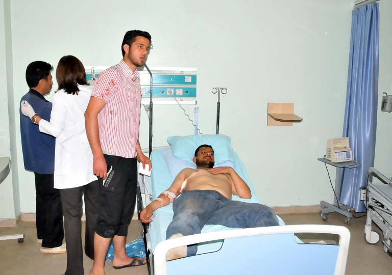<p>A Syrian refugee wounded in shootings along the border between Syria and Turkey lies in a hospital bed today in Kilis. Two Syrians were killed and at least 15 others were wounded in shootings along the border between Syria and Turkey, Anatolia news agency reported, citing local health officials.</p>