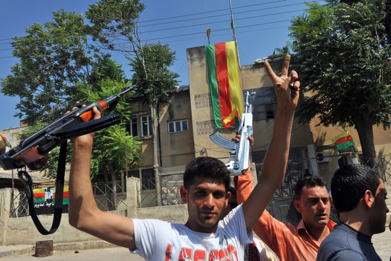 <p>Syrian Kurds hold their rifles, as they flash the sign for victory, in the Kurdish town of Jinderes, near the northern Syrian city of Aleppo, on July 22, 2012, as Kurdish activists on the Syria-Turkey border started taking control of towns in the area without encountering much resistance from the forces loyal to Syrian President Bashar al-Assad.</p>