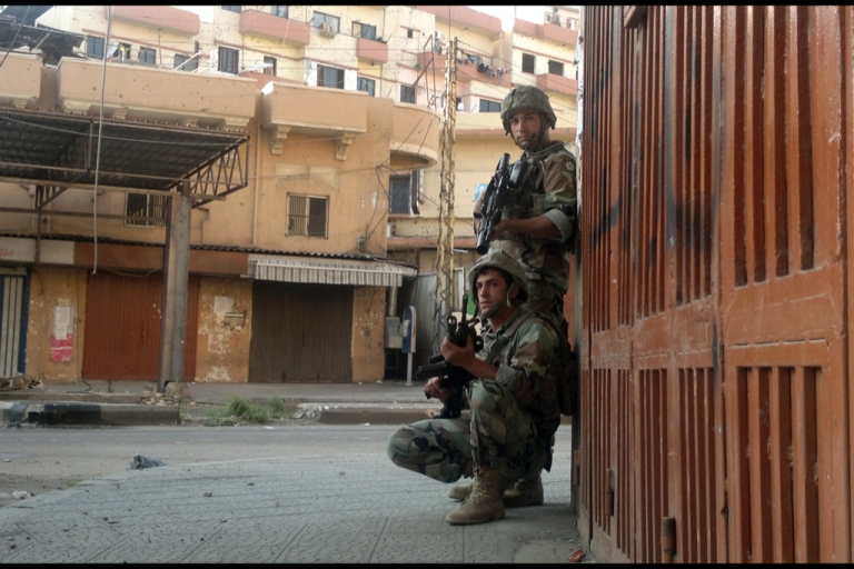 <p>Lebanese army troops enter Bab al-Tebbaneh, one of two rival neighbourhoods in the northern Lebanese port city of Tripoli, on May 15, 2012 to order battling gunmen off the streets. Five people were killed and nearly 20 wounded in sectarian clashes linked to unrest in neighbouring Syria the previous day, according to a security official.</p>