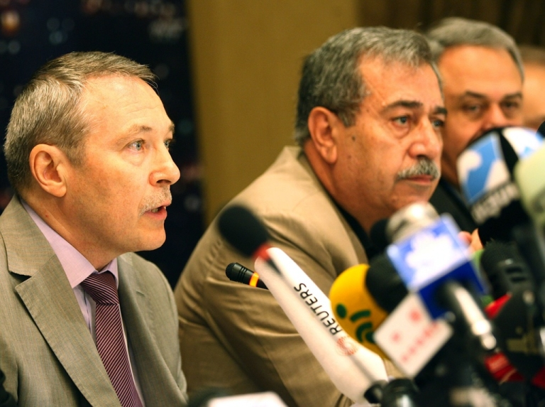 <p>Russian Ambassador to Syria Azmat Allah Kolmahmedov (L) speaks as Raja al-Nasser, long-time opponent to the Syrian government regime and General Secretary of the Coordinating Committee for Democratic National Change, listens on as they attend a National Conference for Rescuing Syria, in Damascus on September 23, 2012. The conferees will discuss ways to get Syria out of the crisis it faces.</p>