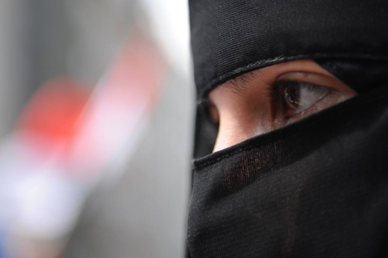 <p>A woman attends an activist demonstration in front of the Syrian consulate in Istanbul, Turkey, on July 29, 2011 to protest President Bashar al-Assad's regime. Participants included Syrians living in Turkey.</p>