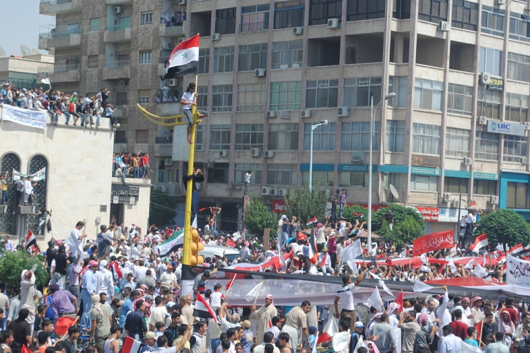 <p>Syrians demonstrate after Friday prayers in the central city of Hama on July 22, 2011.</p>