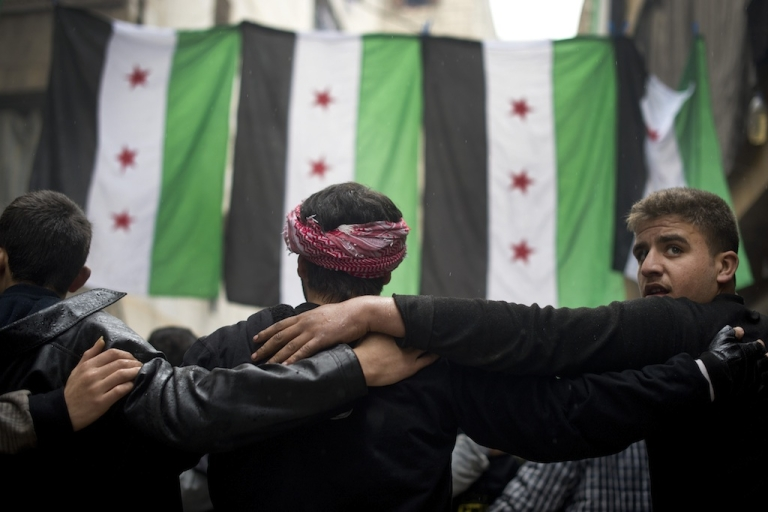 <p>Rebel fighters take part in a demonstration against the Syrian regime after the Friday prayer in the al-Fardos neighbourhood of Aleppo on December 7, 2012. Russian officials said for the first time last week that opposition forces may be successful in defeating President Bashar al-Assad.</p>