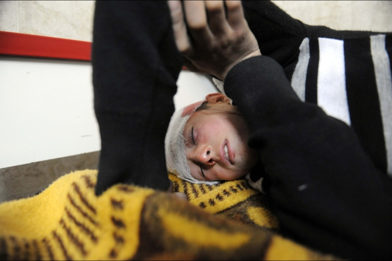 <p>A Syrian youth recovers at a hospital in Idlib in northwestern Syria on February 24, 2012 after he was wounded in an attack amid the regime's deadly crackdown on dissent.</p>