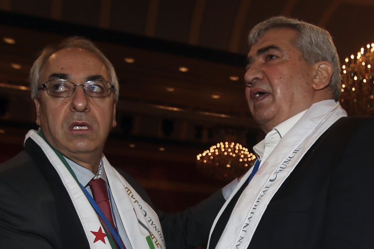 <p>Syrian regime opponent Riad Seif (R) and Syrian National Council (SNC) chief Abdel Basset Sayda attend the General Assembly of the SNC meeting in Doha on Nov. 6, 2012, aimed at forging a more united front against the Syrian regime.</p>