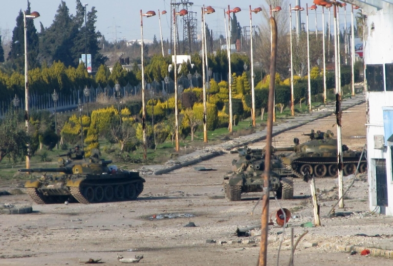 <p>Syrian army tanks are seen stationed at the entrance to Baba Amr neighborhood in Homs on February 13, 2012. Syria ignored a new Arab initiative to end the bloodshed, with its troops pounding the protest hub of Homs as Russia said a ceasefire is needed before peacekeepers can be deployed. -/AFP PHOTO</p>