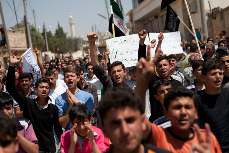 <p>Syrian protesters shout slogans during an anti-regime demonstration in the town of Atareb, 30km west of Aleppo, on April 27, 2012. Tens of thousands protested across Syria as a deadly suicide bombing rocked the capital, killing 11 people and fueling growing skepticism over the prospects of a UN-backed peace plan.</p>