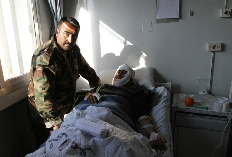 <p>A Syrian man who was wounded in an earlier suicide attack on Dec. 23 rests at a hospital in Damascus.</p>