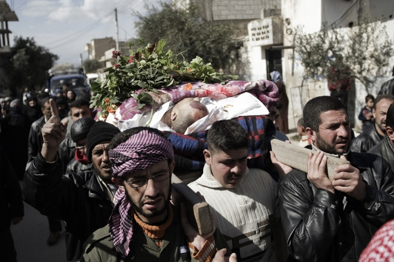 <p>Syrian mourners carry the body of a man who was killed by a shrapnel during his funeral in Qusayr, 15 kms (nine miles) from Homs, on February 28, 2012. Leaders meeting at the European Union summit on March 2, 2012, called upon the Syrian government to end the violence, with British Prime Minister David Cameron saying that the authorities would face