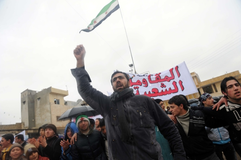 <p>Syrians demonstrate against the regime after Friday prayers in the north Syrian city of Idlib on February 17, 2012. Thousands of Syrians rallied to demand Bashar al-Assad's ouster, as the embattled president's forces unleashed their heaviest pounding yet of Homs in a brutal bid to crush dissent, monitors said. AFP PHOTO/BULENT KILIC</p>