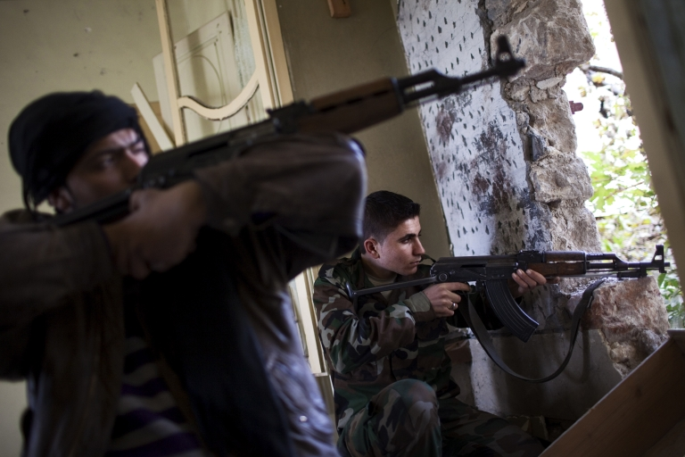 <p>Syrian rebels on Dec. 21, 2012 in Aleppo, Syria.</p>