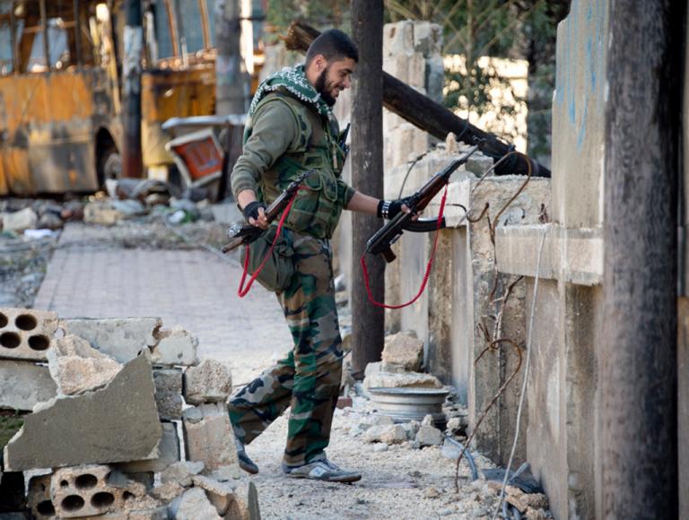 <p>A Syrian rebel fighter in the Aleppo neighborhood of Bustan al-Basr on Dec. 8, 2012.</p>
