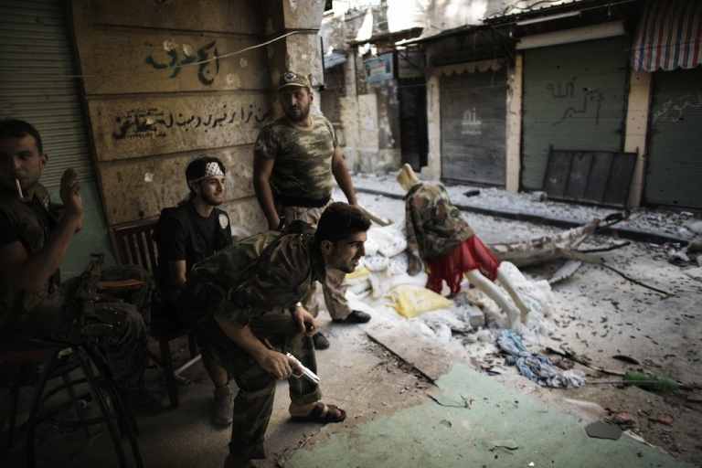 <p>Free Syria Army fighters man a position in the city of Aleppo on Sept. 16, 2012. More than 27,000 people have been killed since the uprising against President Bashar al-Assad's rule erupted in March last year, the Britain-based Observatory estimates. The United Nations puts the toll at 20,000.</p>