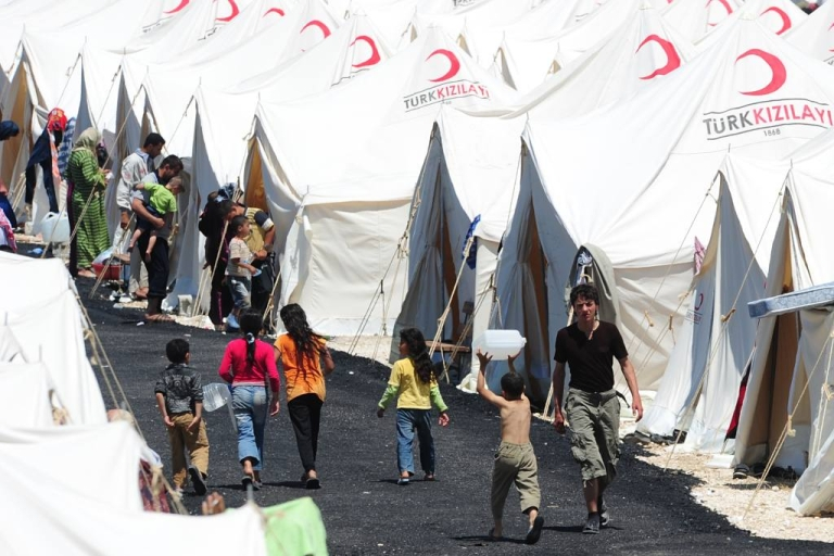 """<p>Syrian refugees at the Boynuyogun Turkish Red Crescent refugee camp in the Altinozu district of Hatay, near the Syrian border. Thousands of Syrian civilians have fled to Turkey from the region after Syria's army began operations to """"restore security"""" near the Turkish border.</p>"""