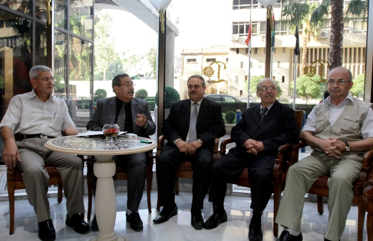 <p>Representatives of the Syrian opposition tolerated by the regime (L-R) Akram Akrami, Raja Nasser, Mahmud Marei, Hassan Abdel Azim and Mahmud Said Rassas wait to meet with international envoy Lakhdar Brahimi in Damascus on September 14, 2012. Brahimi also met Syrian opposition figures whom said he were bringing 'new ideas' to peace efforts as blasts rocked Damascus.</p>