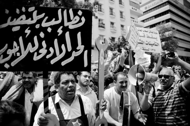 <p>Workers rally for social justice in Tahrir Square in Cairo on May 1, 2012.</p>