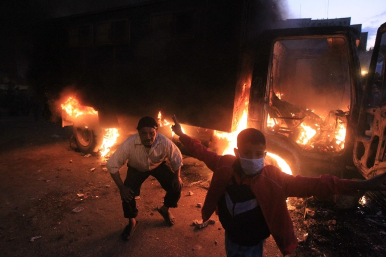 <p>An Egyptian police vehicle burns as protesters clash with riot police at Cairo's landmark Tahrir Square on November 19, 2011. Egyptian police fired rubber bullets and tear gas to break up a sit-in among whose organisers were people injured during the Arab Spring which overthrew veteran president Hosni Mubarak.</p>