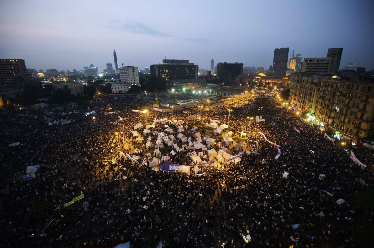 <p>Tens of thousands people take part in a mass rally against a decree by President Mohamed Morsi granting himself broad powers on November 27, 2012 at Egypt's landmark Tahir Square in Cairo. Egyptians face a grim choice between an Islamist constitution and a return to dictatorship.</p>