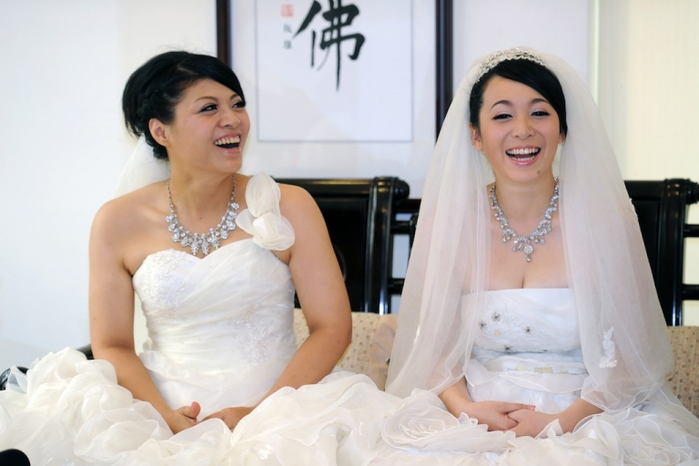 <p>Huang Mei-yu (L) and her partner You Ya-ting smiling during their same-sex Buddhist wedding ceremony. A Buddhist cleric's decision to wed two women in Taiwan is the latest sign that obstacles to same-sex unions are quietly coming down in Asia, with religion posing less of a hindrance than in the west.</p>