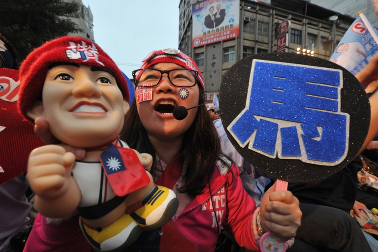 <p>Supporters of re-elected Taiwan President Ma Ying-jeou cheer in Taipei on Jan. 14, 2012.</p>