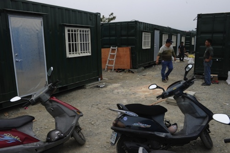 <p>Workers modify freight containers being converted into shelters for alleged cult members in Taiwan. Dozens of Taiwanese have reportedly rushed to prepare makeshift shelters in central Taiwan after the man, known only as 'Teacher Wang', alleged that a huge earthquake and tsunami would destroy the island next month.</p>