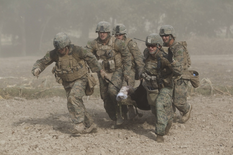 <p>In this picture taken on November 2, 2011 and cleared on December 20,2011 by the US Army , US Marines, through a haze of fine dust kicked up by the helicopter's rotor blades, carry a wounded comrade who was hit by an Improvised Explosive Device (IED) to a medevac helicopter of the US Army's Task Force Lift 'Dust Off', Charlie Company 1-171 Aviation Regiment in Helmand province. The Marine lost his right leg from the knee in the blast.</p>