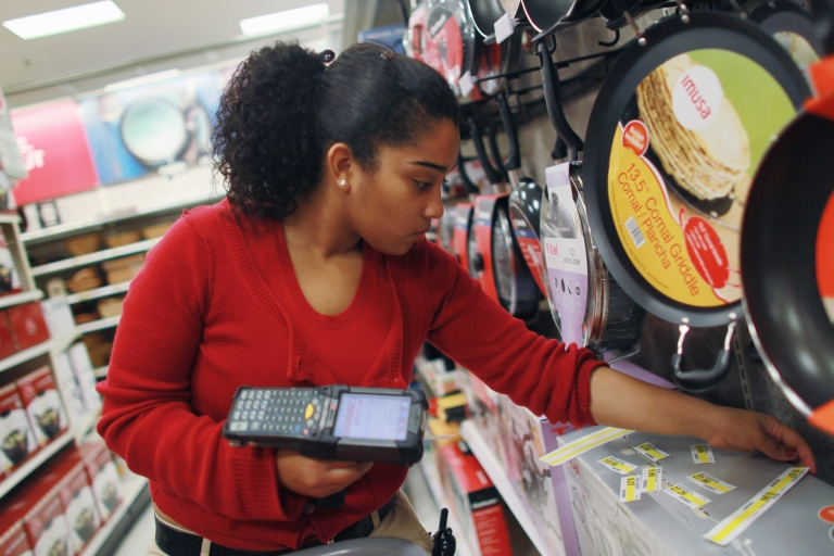 <p>Joanely Carrero restocks shelves at a Target store in Miami, Florida. Target just said it would stop selling Amazon's kindle. Target has become an Amazon showroom and that's made Amazon more of a foe than friend for Target.</p>