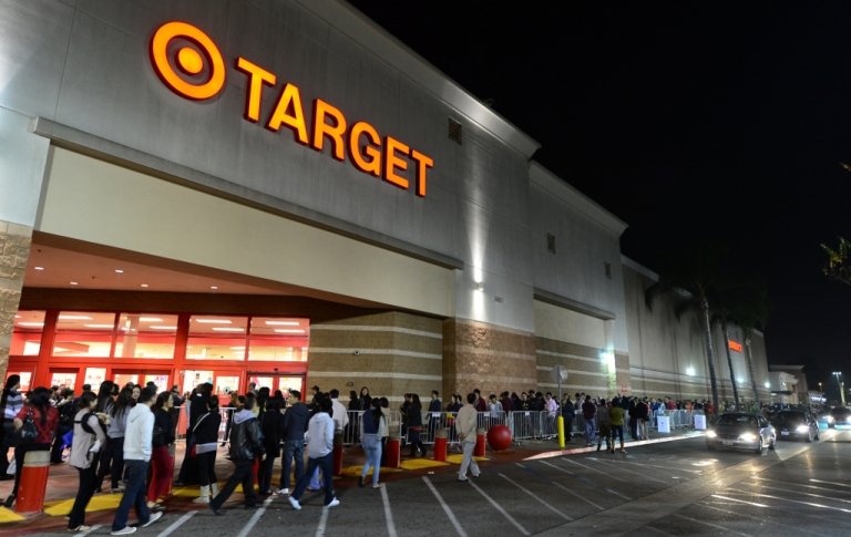 <p>People wait in line to get an early start on Black Friday shopping deals at a Target store on November 22, 2012 in Rosemead, California.</p>