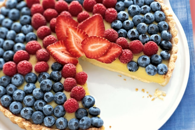 <p>This white balsamic custard tart with a fresh berry topping from Bon Appetit is sure to outshine the other desserts at your potluck BBQ with its star-shaped raspberry pattern. The recipe can be found here: <a href=