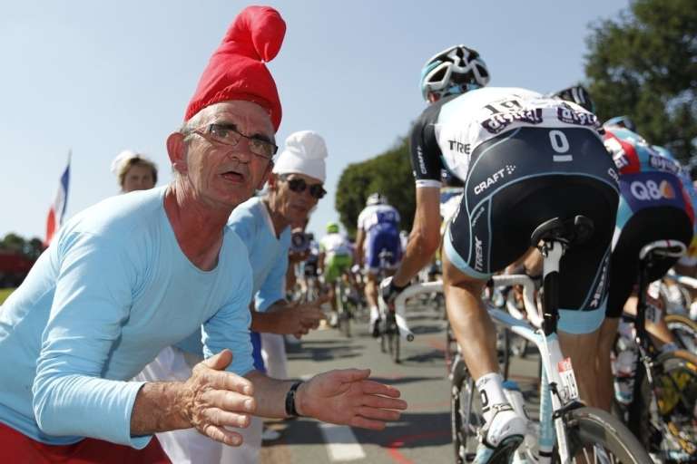 <p>Fans dress as papa smurfs along the race route on July 2, 2011 during the first stage of the Tour de France in western France.</p>