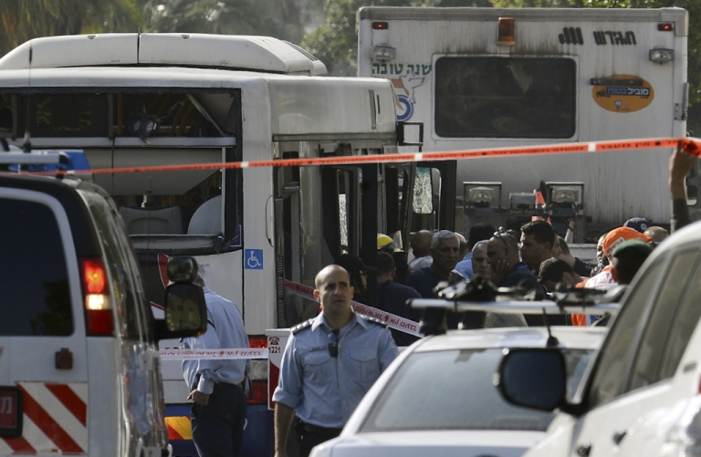 <p>Israeli police seal off the area surrounding the bus which was hit by a bomb near the defence ministry in Tel Aviv on November 21, 2012. At least 10 people were injured in an explosion on a bus, Israel's emergency services said, in what an official said was