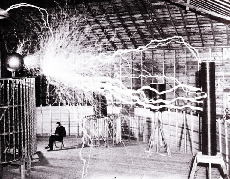<p>Publicity photo of Nikola Tesla sitting in his laboratory in Colorado Springs in December 1899, the same year the laboratory was built. The photo was taken by Dickenson V. Alley, photographer at the Century Magazines. Tesla sent a copy of this photograph to Sir William Crookes in England in 1901.</p>