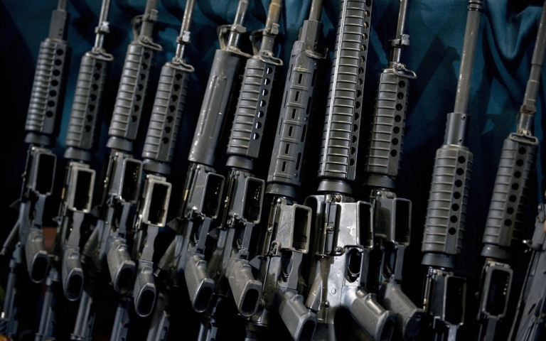 <p>Guns seized in the arrest of an alleged member of the drugs cartel Los Zetas are displayed to news media in Mexico City in December.</p>
