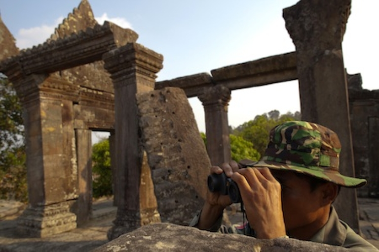 <p>A Cambodian solider looks across at the Thai border from the ancient Preah Vihear temple where a military camp has been set up February 9, 2011 in Preah Vihear province, Cambodia.</p>