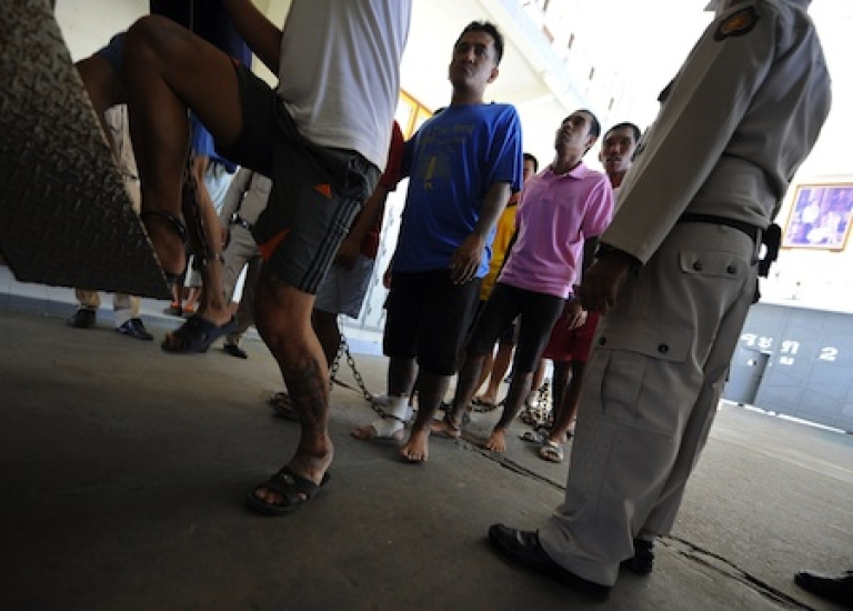 <p>Prisoners are evacuated from Klong Prem Central Prison during heavy flooding in Bangkok, Thailand, on October 26, 2011.</p>