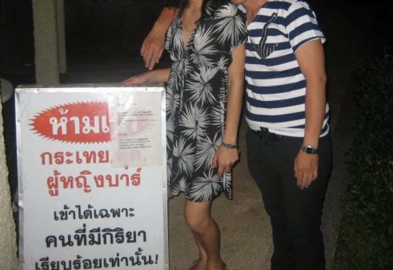 <p>A sign outside a Thai nightclub reads