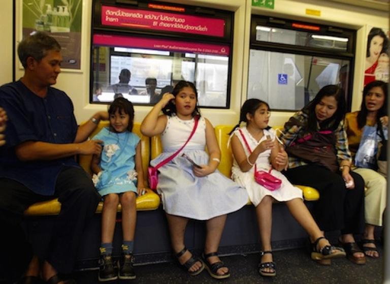<p>A family rides Bangkok's elevated