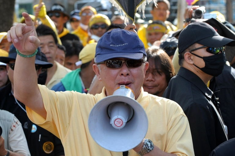 <p>Thai Yellow Shirt leader Sondhi Limthongkul speaks during a protest in front of Parliament in Bangkok on Nov. 24, 2008. He has just been sentenced to 20 years in prison for corporate fraud, but says he will appeal.</p>