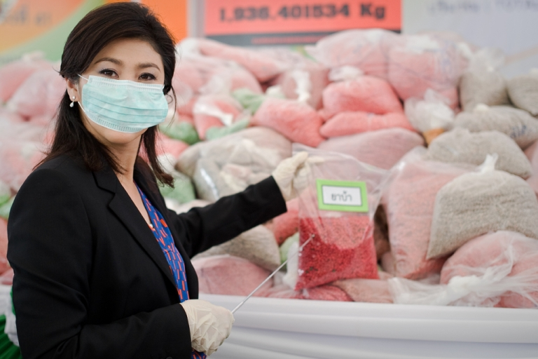 <p>Prime Minister Yingluck Shinawatra stands in front of bags of methamphetamine tablets during the 41th Destruction of Confiscated Narcotics ceremony in Ayutthaya province,Thailand, June 29, 2012.</p>